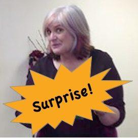 Christi holding surprise